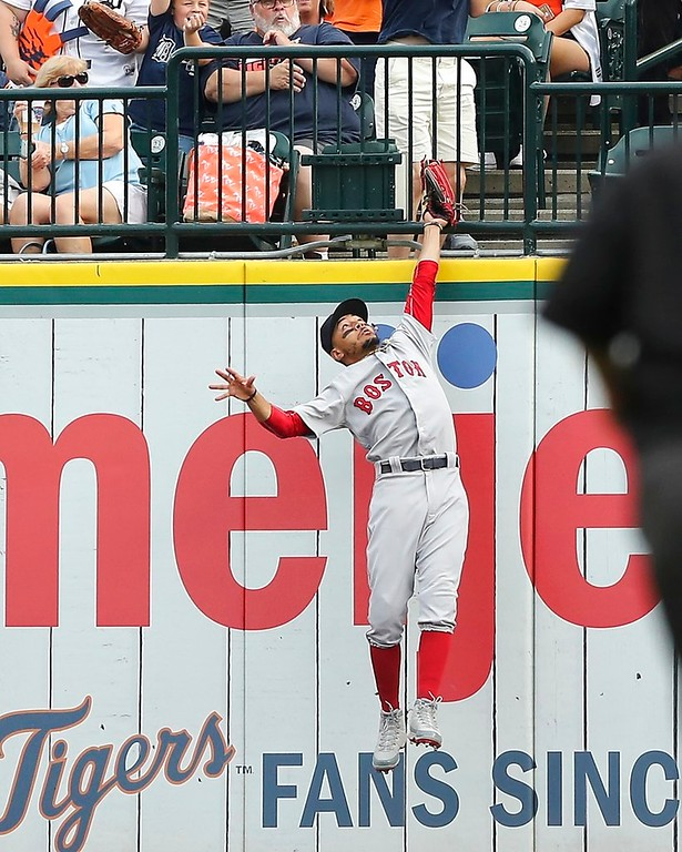 . Boston Red Sox right fielder Mookie Betts catches the fly out hit by Detroit Tigers\' Leonys Martin at the wall during the third inning of a baseball game, Saturday, July 21, 2018, in Detroit. (AP Photo/Carlos Osorio)