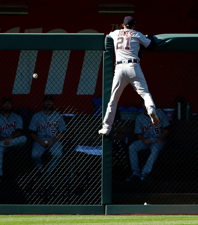 . Detroit Tigers left fielder JaCoby Jones watches a home run hit by Kansas City Royals\' Abraham Almonte fall into the Detroit bullpen during the sixth inning of a baseball game at Kauffman Stadium in Kansas City, Mo., Saturday, May 5, 2018. (AP Photo/Colin E. Braley)