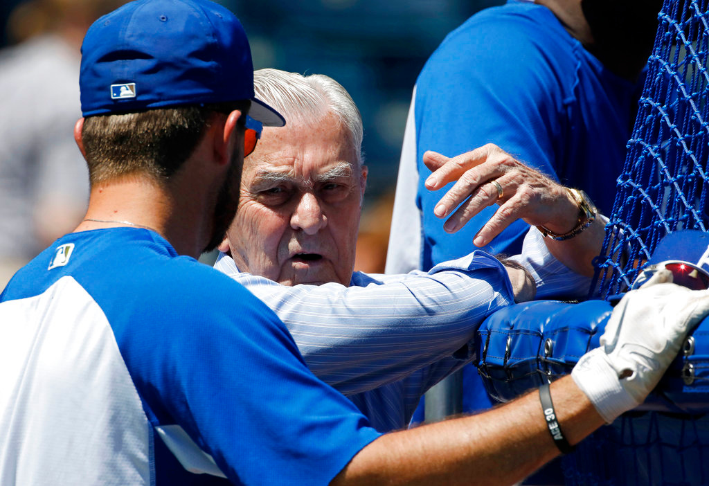 . Kansas City Royals owner David Glass talks with catcher Drew Butera during batting practice before a baseball game against the Detroit Tigers at Kauffman Stadium in Kansas City, Mo., Saturday, May. 5, 2018. (AP Photo/Colin E. Braley)