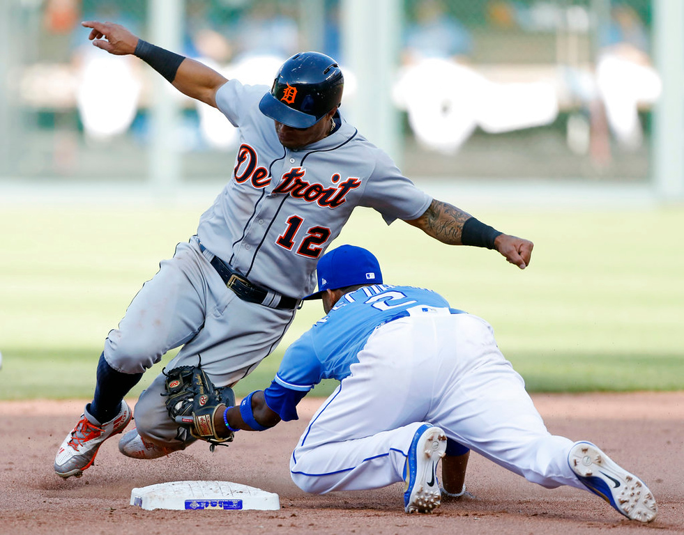 . Detroit Tigers\' Leonys Martin (12) is tagged out by Kansas City Royals shortstop Alcides Escobar (2) after attempting to steal second base in the ninth inning of a baseball game at Kauffman Stadium in Kansas City, Mo., Saturday, May 5, 2018. (AP Photo/Colin E. Braley)