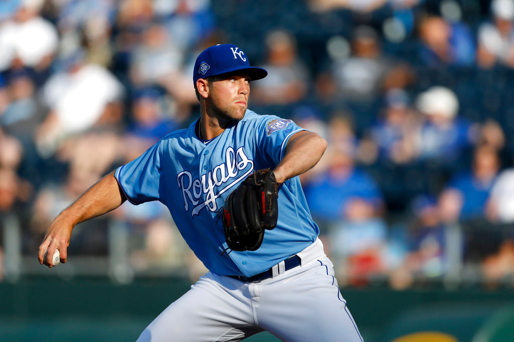 . Kansas City Royals relief pitcher Jason Adam makes his major league debut as he throws to the Detroit Tigers in the ninth inning of a baseball game at Kauffman Stadium in Kansas City, Mo., Saturday, May 5, 2018. (AP Photo/Colin E. Braley)