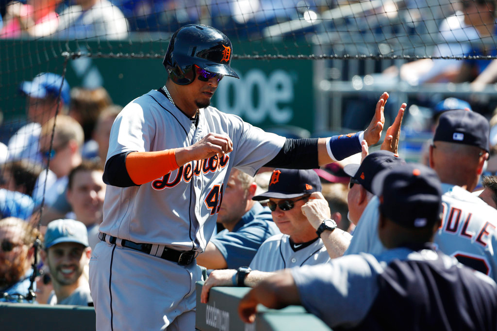 . Detroit Tigers designated hitter Victor Martinez, left, is congratulated after scoring in the first inning of a baseball game against the Kansas City Royals at Kauffman Stadium in Kansas City, Mo., Saturday, May 5, 2018. (AP Photo/Colin E. Braley)
