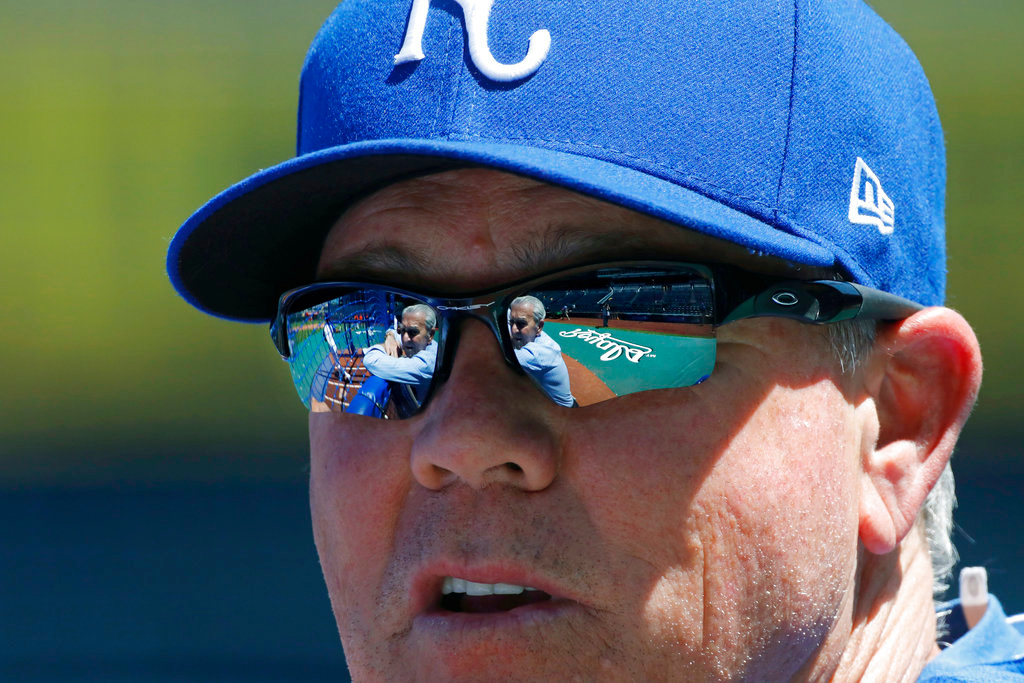 . Kansas City Royals owner David Glass is reflected in the sunglasses of manager Ned Yost as they chat during batting practice before a baseball game against the Detroit Tigers at Kauffman Stadium in Kansas City, Mo., Saturday, May 5, 2018. (AP Photo/Colin E. Braley)