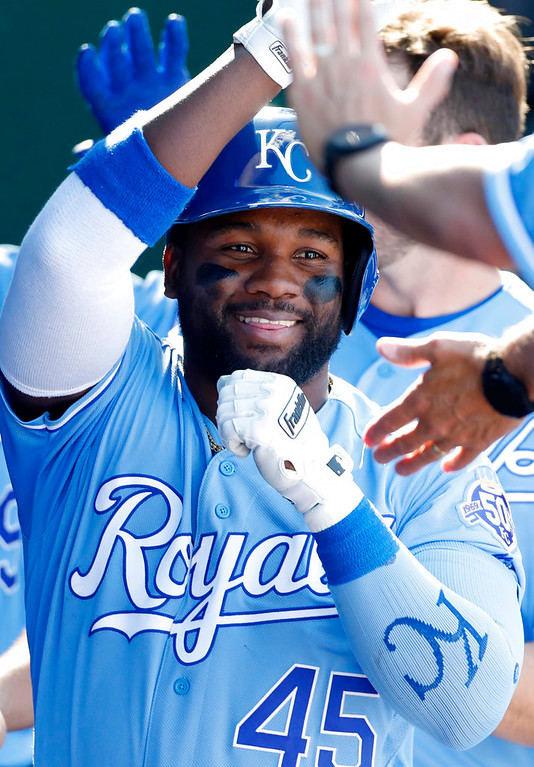 . Kansas City Royals\' Abraham Almonte celebrates in the dugout after hitting a home run in the sixth inning of a baseball game against the Detroit Tigers at Kauffman Stadium in Kansas City, Mo., Saturday, May 5, 2018. (AP Photo/Colin E. Braley)