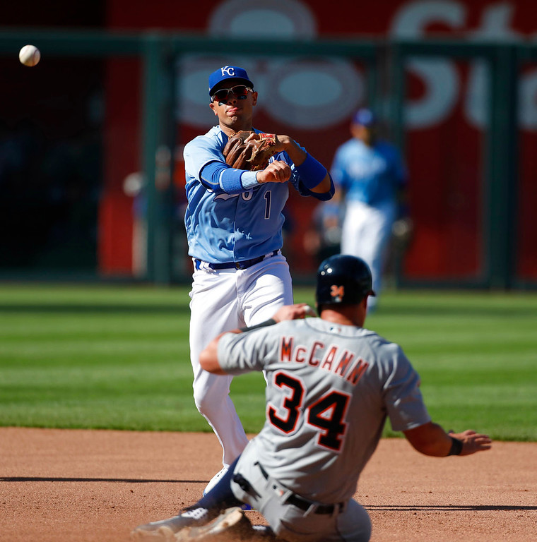 . Detroit Tigers\' James McCann (34) slides into a double play as Kansas City Royals second baseman Ryan Goins (1) throws to first in the sixth inning of a baseball game at Kauffman Stadium in Kansas City, Mo., Saturday, May 5, 2018. Julio Iglesias was out at first. (AP Photo/Colin E. Braley)