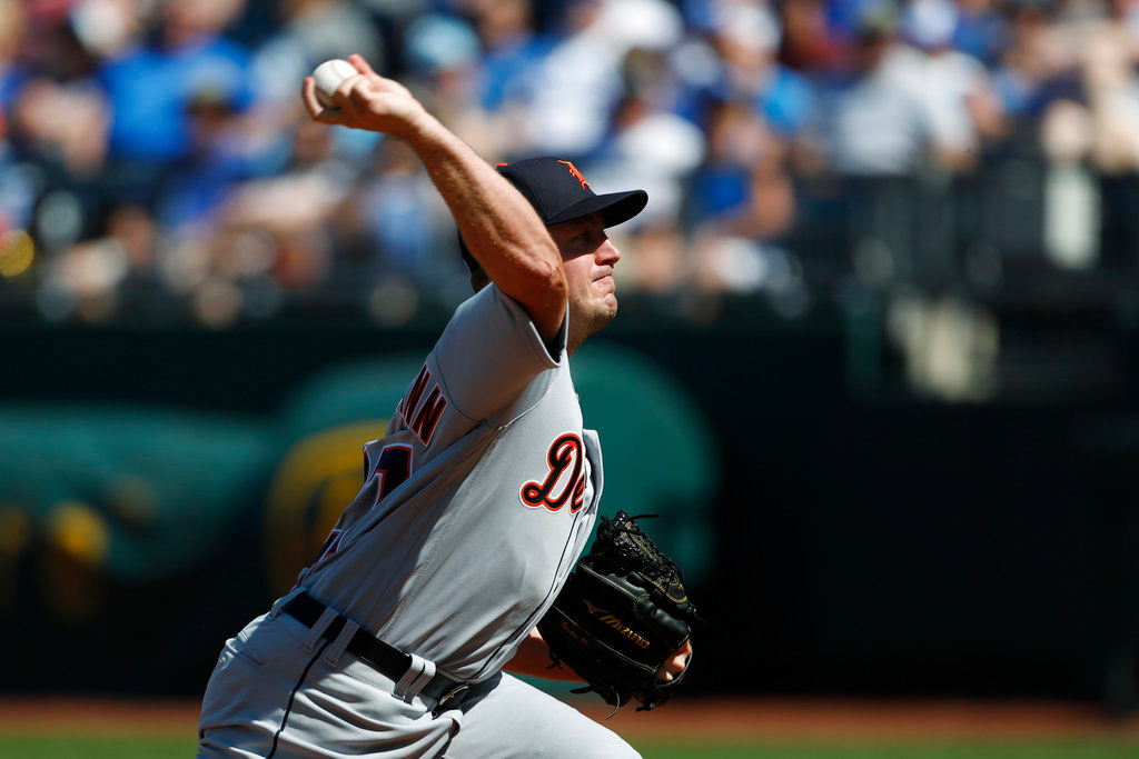 . Detroit Tigers pitcher Jordan Zimmermann throws against a Kansas City Royals batter in the first inning of a baseball game at Kauffman Stadium in Kansas City, Mo., Saturday, May 5, 2018. (AP Photo/Colin E. Braley)