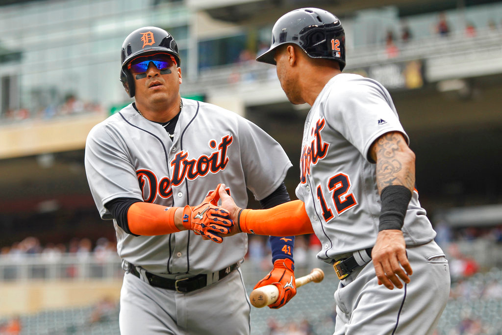 . Detroit Tigers Victor Martinez celebrates the run scored by Leonys Martin (12) after he hit a sacrifice fly against the Minnesota Twins to score him in the first inning of a baseball game Wednesday, May 23, 2018, in Minneapolis. (AP Photo/Bruce Kluckhohn)