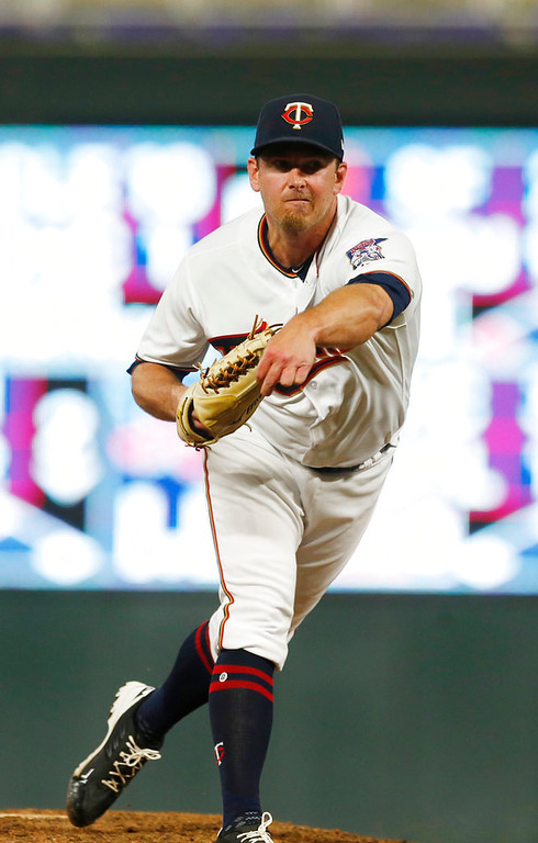 . Minnesota Twins pitcher Zach Duke throws against the Detroit Tigers in a baseball game Tuesday, May 22, 2018, in Minneapolis. (AP Photo/Jim Mone)