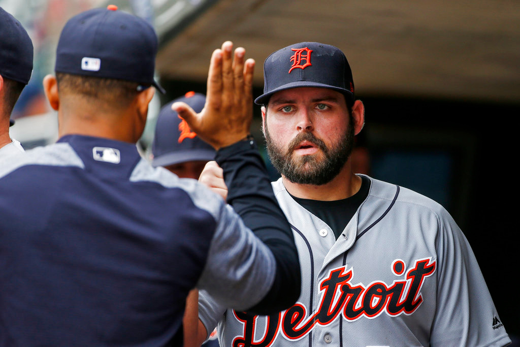 . Detroit Tigers starting pitcher Michael Fulmer gets a high five after he finished throwing to the Minnesota Twins in the sixth inning of a baseball game Wednesday, May 23, 2018, in Minneapolis. The Tigers won 4-1 and Fulmer got the win. (AP Photo/Bruce Kluckhohn)