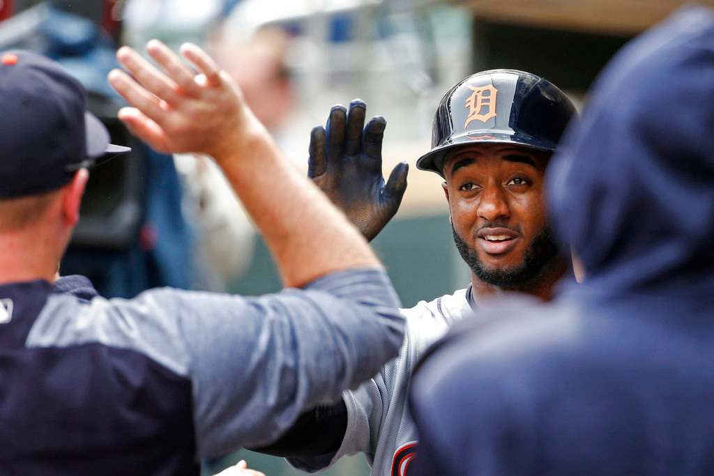 . Detroit Tigers Niko Goodrum celebrates his run against the Minnesota Twins in the ninth inning of a baseball game Wednesday, May 23, 2018, in Minneapolis. The Tigers won 4-1 and Goodrum hit a two run homer earlier in the game. (AP Photo/Bruce Kluckhohn)