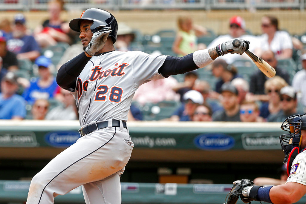 . Detroit Tigers Niko Goodrum hits a double against the Minnesota Twins in the ninth inning of a baseball game Wednesday, May 23, 2018, in Minneapolis. The Tigers won 4-1. (AP Photo/Bruce Kluckhohn)