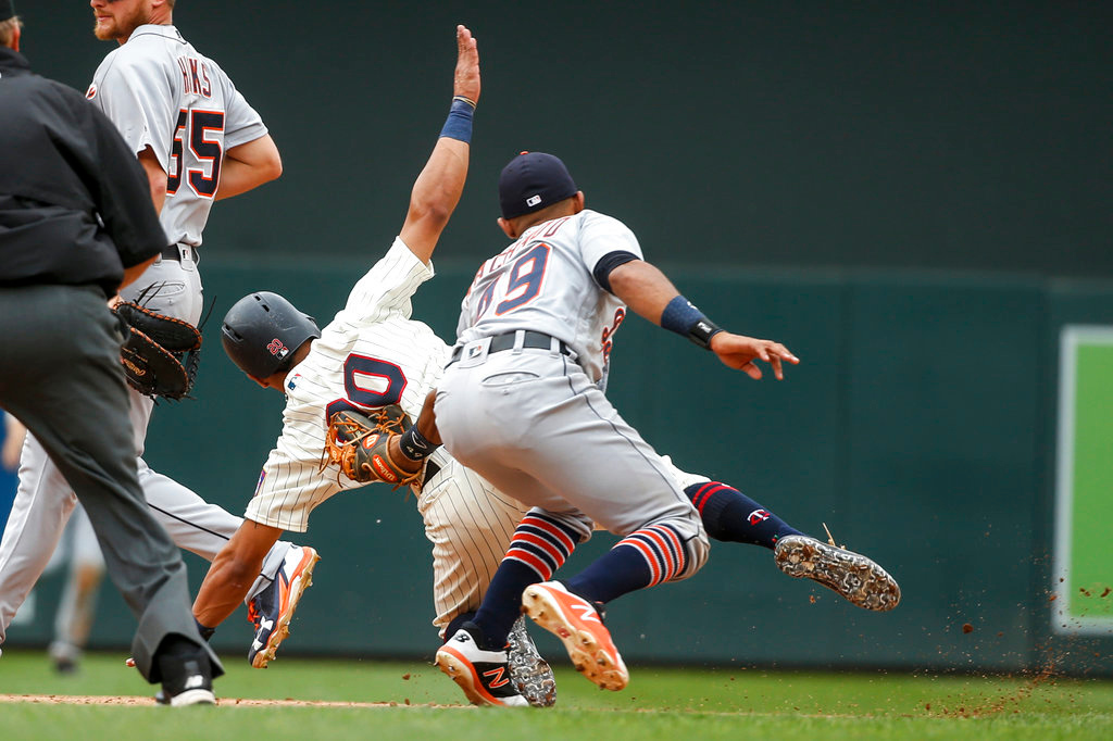 . Detroit Tigers shortstop Dixon Machado tags out Minnesota Twins left fielder Eddie Rosario to complete a double play in the sixth inning of a baseball game Wednesday, May 23, 2018, in Minneapolis. The Tigers won 4-1.(AP Photo/Bruce Kluckhohn)