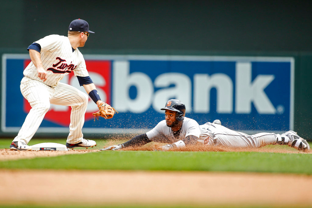 . Detroit Tigers Niko Goodrum dives into second base for a double ahead of the tag by Minnesota Twins second baseman Brian Dozier in the ninth inning of a baseball game Wednesday, May 23, 2018, in Minneapolis. The Tigers won 4-1. (AP Photo/Bruce Kluckhohn)