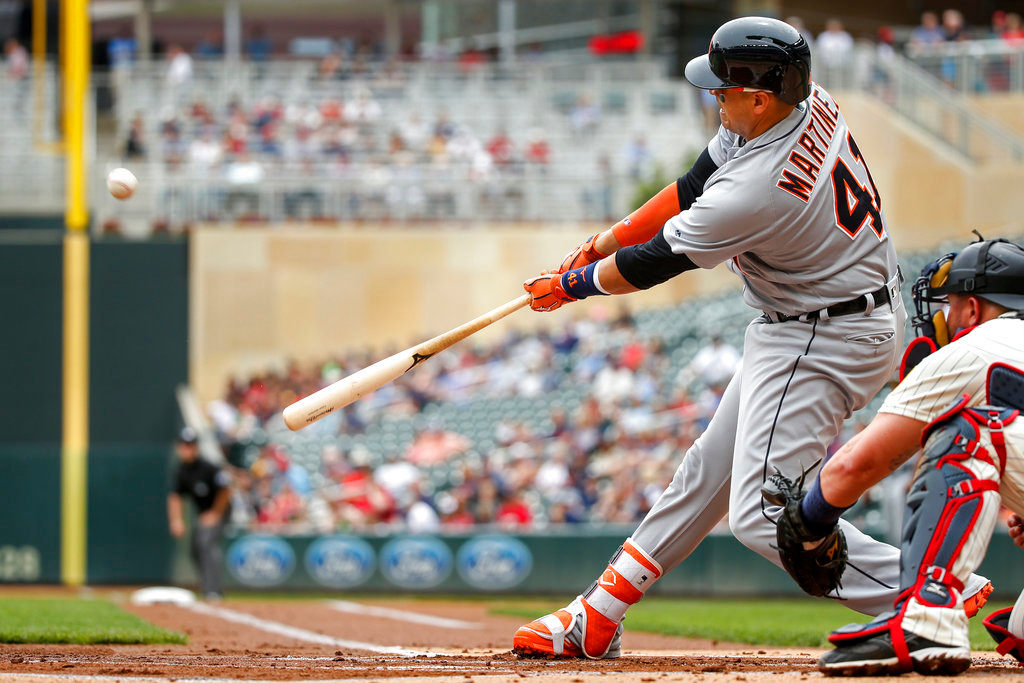. Detroit Tigers Victor Martinez hits in a run on a sacrifice fly against the Minnesota Twins in the first inning of a baseball game Wednesday, May 23, 2018, in Minneapolis. The Tigers won 4-1. (AP Photo/Bruce Kluckhohn)