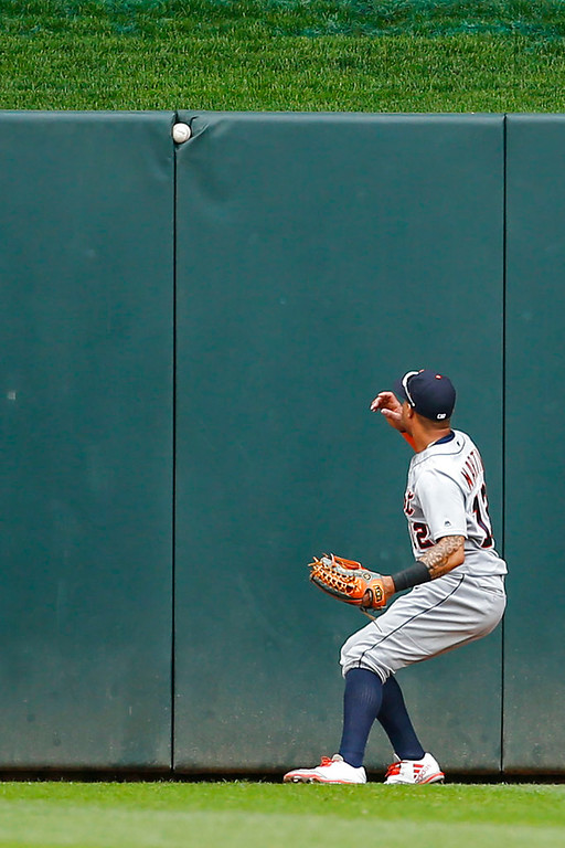 . Detroit Tigers center fielder Leonys Martin looks to a ball that is lodged in the wall resulting in a ground rule double for Minnesota Twins second baseman Brian Dozier in the first inning of a baseball game Wednesday, May 23, 2018, in Minneapolis. The Tigers won 4-1.(AP Photo/Bruce Kluckhohn)