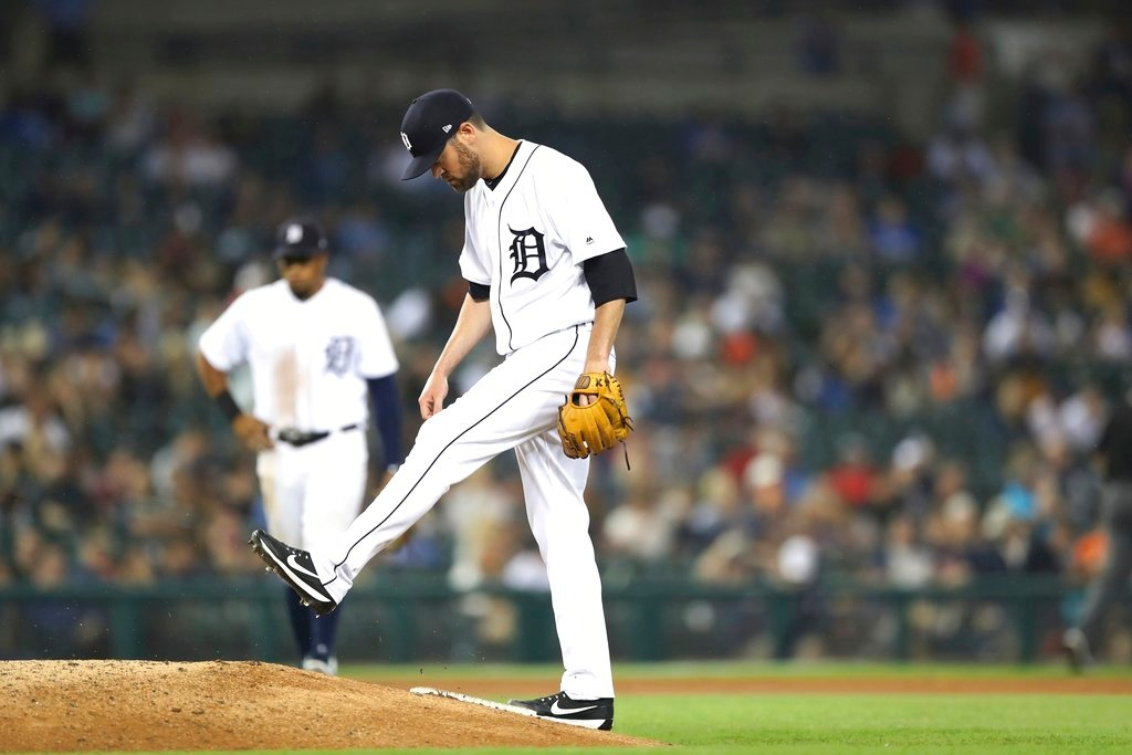. Detroit Tigers relief pitcher Louis Coleman kicks the mound after loading the bases during the seventh inning of a baseball game against the Minnesota Twins, Tuesday, June 12, 2018, in Detroit. (AP Photo/Carlos Osorio)