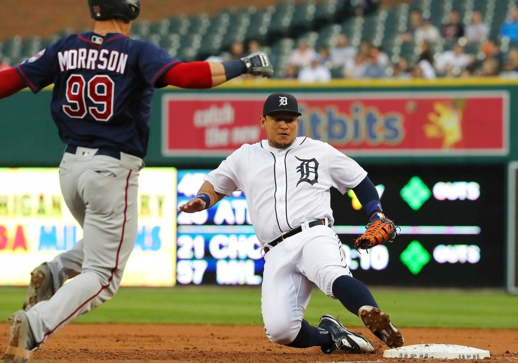 . Detroit Tigers first baseman Miguel Cabrera slides into first after fielding the grounder hit by Minnesota Twins\' Logan Morrison (99) for the out during the third inning of a baseball game Tuesday, June 12, 2018, in Detroit. (AP Photo/Carlos Osorio)