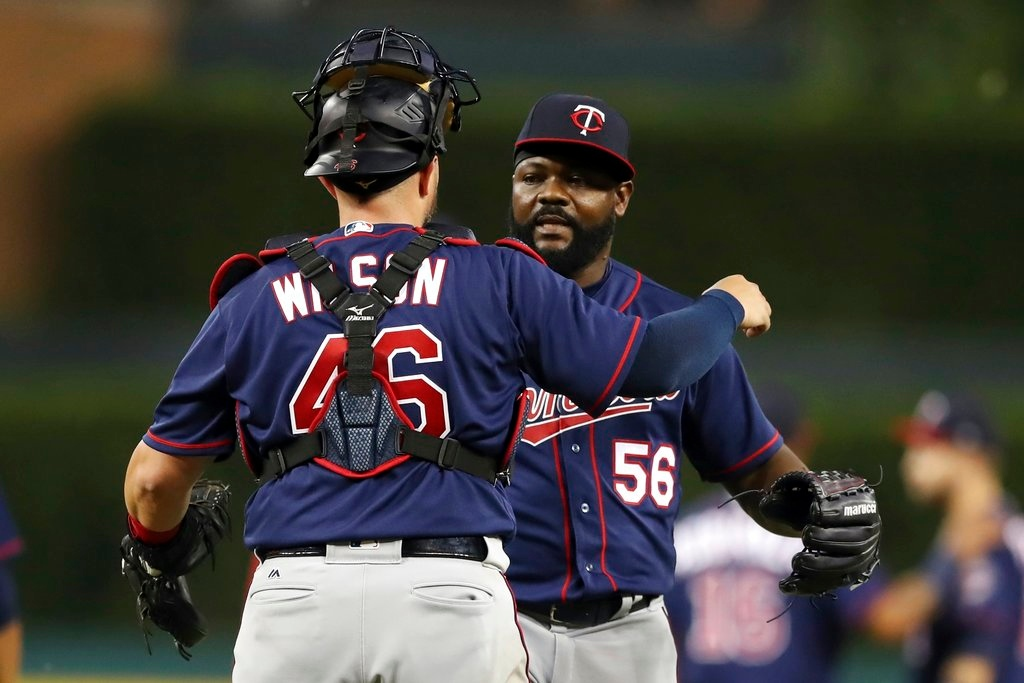 . Minnesota Twins relief pitcher Fernando Rodney (56) hugs catcher Bobby Wilson after the Twins\' 6-4 win over the Detroit Tigers in a baseball game Tuesday, June 12, 2018, in Detroit. (AP Photo/Carlos Osorio)