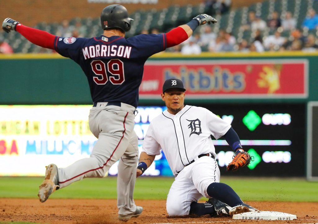 . Detroit Tigers first baseman Miguel Cabrera slides into first after fielding the grounder hit by Minnesota Twins\' Logan Morrison (99) for the out during the third inning of a baseball game, Tuesday, June 12, 2018, in Detroit. (AP Photo/Carlos Osorio)