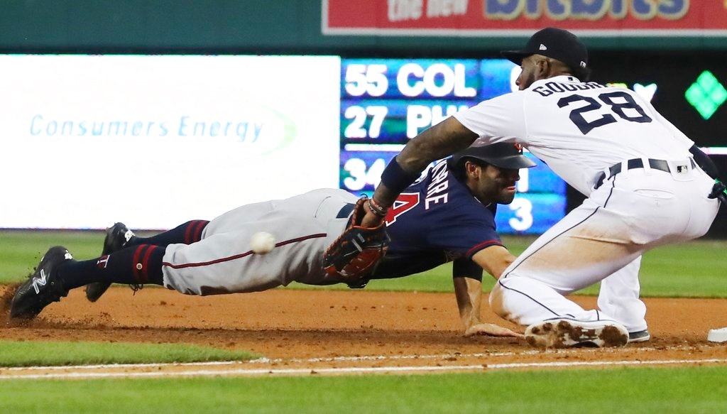 . Minnesota Twins\' Ryan LaMarre dives back to first as Detroit Tigers first baseman Niko Goodrum waits for the throw during the sixth inning of a baseball game Tuesday, June 12, 2018, in Detroit. LaMarre was out on the play. (AP Photo/Carlos Osorio)