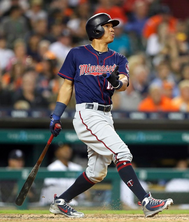 . Minnesota Twins\' Ehire Adrianza follows through on his grand slam during the seventh inning of a baseball game against the Detroit Tigers, Tuesday, June 12, 2018, in Detroit. (AP Photo/Carlos Osorio)
