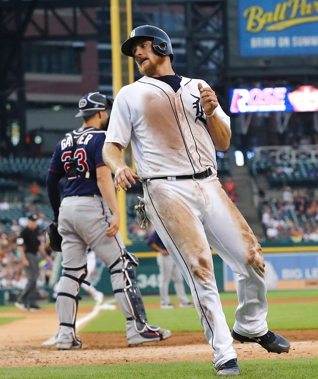 . Detroit Tigers\' John Hicks turns to head to the dugout after scoring from first on a triple by Jose Iglesias during the fourth inning of a baseball game against the Minnesota Twins, Tuesday, June 12, 2018, in Detroit. (AP Photo/Carlos Osorio)