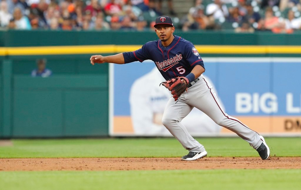 . Minnesota Twins third baseman Eduardo Escobar chases a grounder during the third inning of a baseball game against the Detroit Tigers, Tuesday, June 12, 2018, in Detroit. (AP Photo/Carlos Osorio)