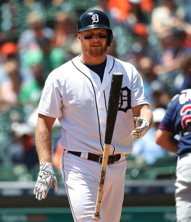 . Detroit Tigers\' John Hicks flips his bat after striking out during the first inning of a baseball game against the Minnesota Twins, Thursday, June 14, 2018, in Detroit. (AP Photo/Carlos Osorio)