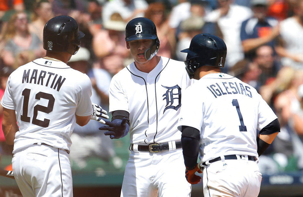 . Detroit Tigers\' JaCoby Jones, center, and Jose Iglesias are greeted by Leonys Martin (12) after Jones\' two-run home run during the seventh inning of a baseball game against the Minnesota Twins, Thursday, June 14, 2018, in Detroit. (AP Photo/Carlos Osorio)