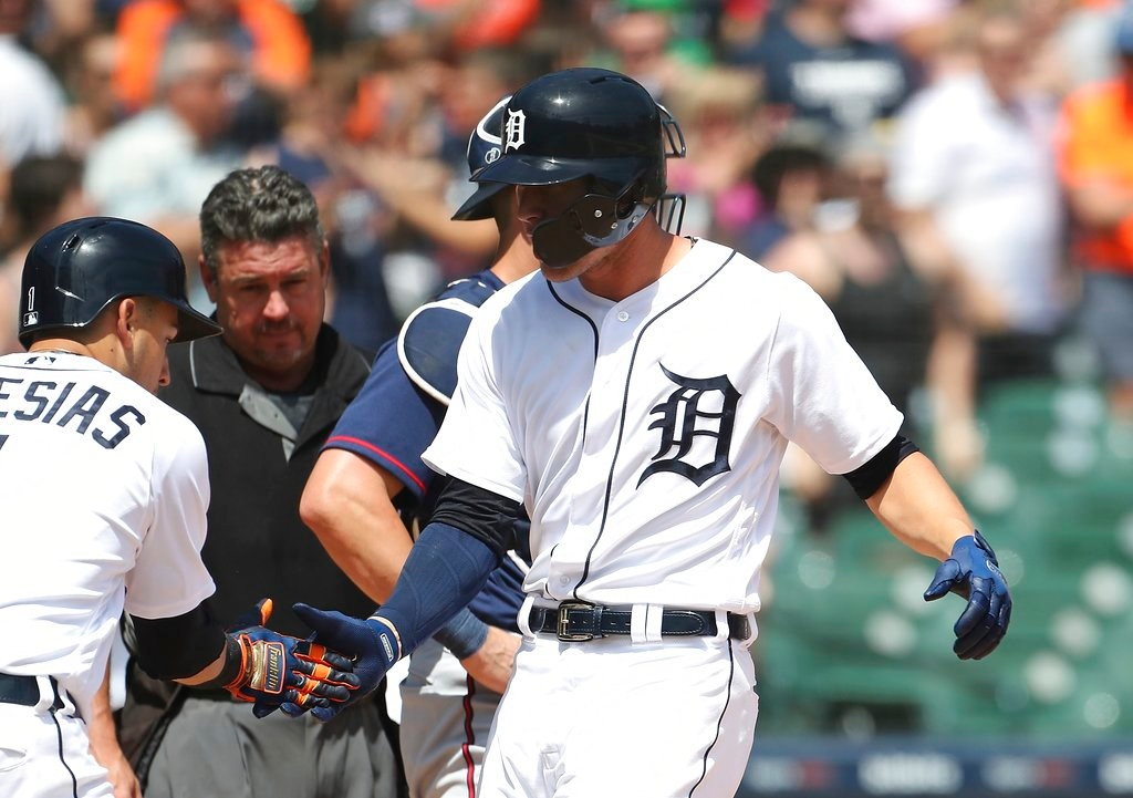 . Detroit Tigers\' JaCoby Jones, right, is greeted at home plate by Jose Iglesias (1) after hitting a two-run home run during the seventh inning of a baseball game against the Minnesota Twins, Thursday, June 14, 2018, in Detroit. (AP Photo/Carlos Osorio)