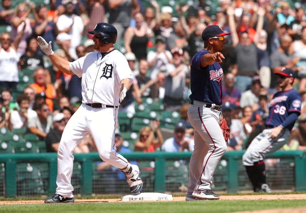 . Detroit Tigers\' John Hicks reacts after hitting a triple during the seventh inning of a baseball game against the Minnesota Twins, Thursday, June 14, 2018, in Detroit. (AP Photo/Carlos Osorio)
