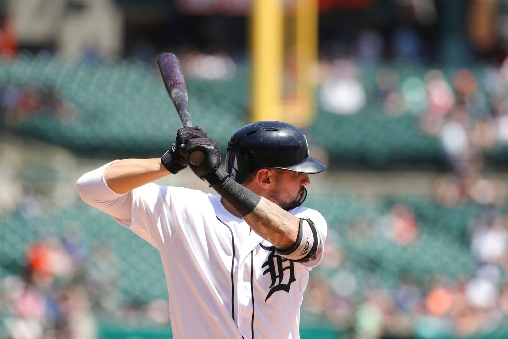 . Detroit Tigers\' Nicholas Castellanos bats during the eighth inning of a baseball game against the Minnesota Twins, Thursday, June 14, 2018, in Detroit. (AP Photo/Carlos Osorio)