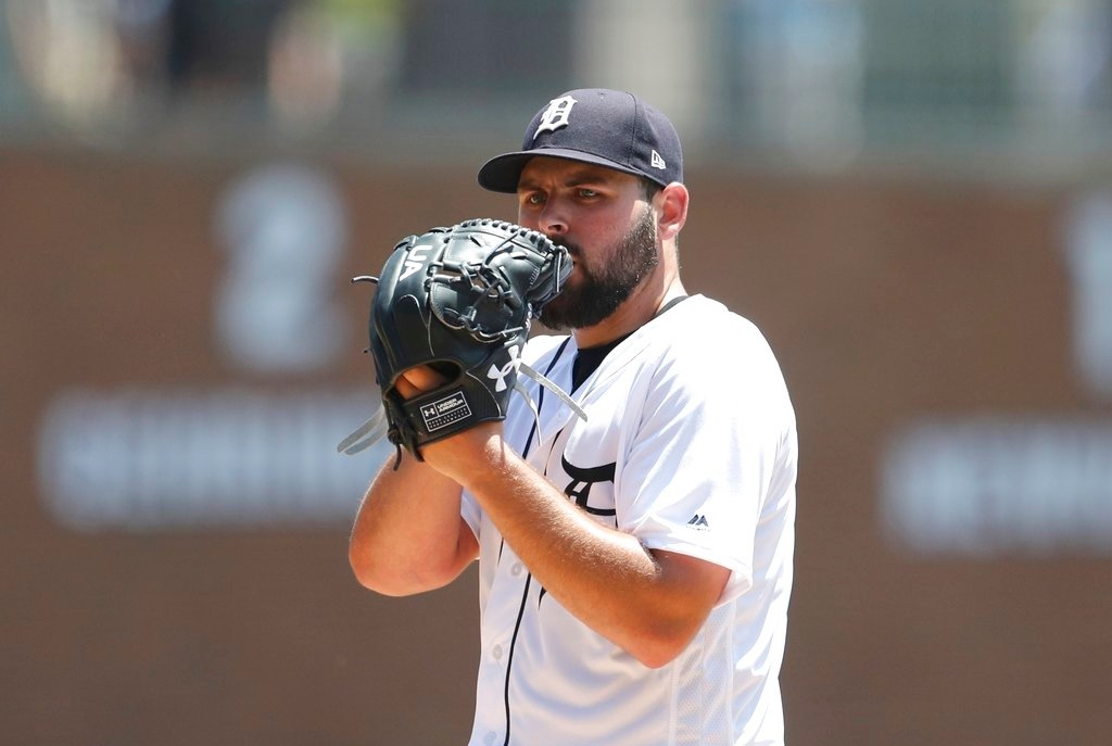 . Detroit Tigers starting pitcher Michael Fulmer prepares to throw during the third inning of a baseball game against the Minnesota Twins, Thursday, June 14, 2018, in Detroit. (AP Photo/Carlos Osorio)