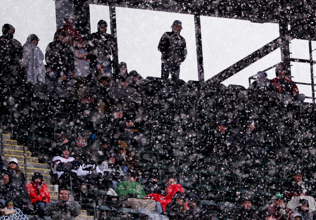 . Baseball fans watch the Chicago White Sox home-opener baseball game against the Detroit Tigers, Thursday, April 5, 2018, in Chicago. (AP Photo/Nam Y. Huh)