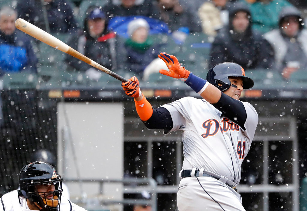 . Detroit Tigers\' Victor Martinez hits a one-run single against the Chicago White Sox during the fifth inning of the White Sox home-opener baseball game Thursday, April 5, 2018, in Chicago. (AP Photo/Nam Y. Huh)