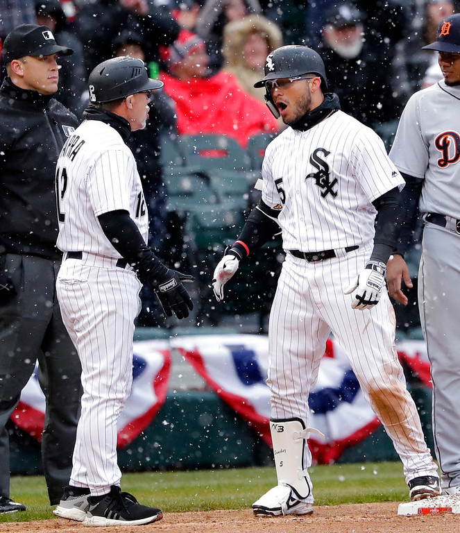 . Chicago White Sox\'s Yolmer Sanchez, right, celebrates with third base coach Nick Capra after hitting an RBI triple during the fifth inning against the Detroit Tigers in a baseball game Thursday, April 5, 2018, in Chicago. (AP Photo/Nam Y. Huh)