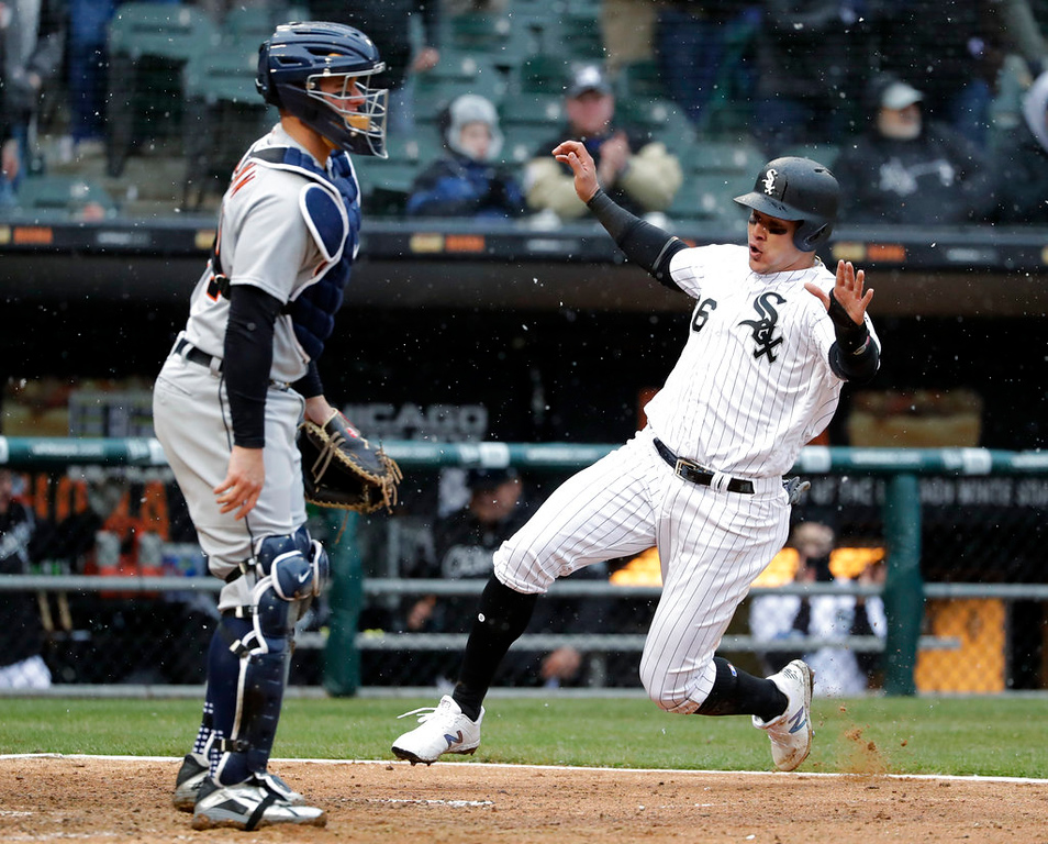 . Chicago White Sox\'s Avisail Garcia, right, scores on a double by Matt Davidson as Detroit Tigers catcher James McCann stands near the plate during the fifth inning of a baseball game Thursday, April 5, 2018, in Chicago. (AP Photo/Nam Y. Huh)