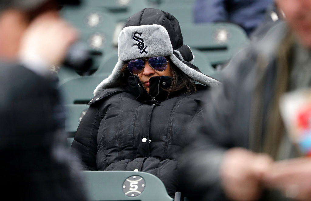 . A Chicago White Sox fan waits for the Chicago White Sox season home-opener baseball game against the Detroit Tigers, Thursday, April 5, 2018, in Chicago. (AP Photo/Nam Y. Huh)