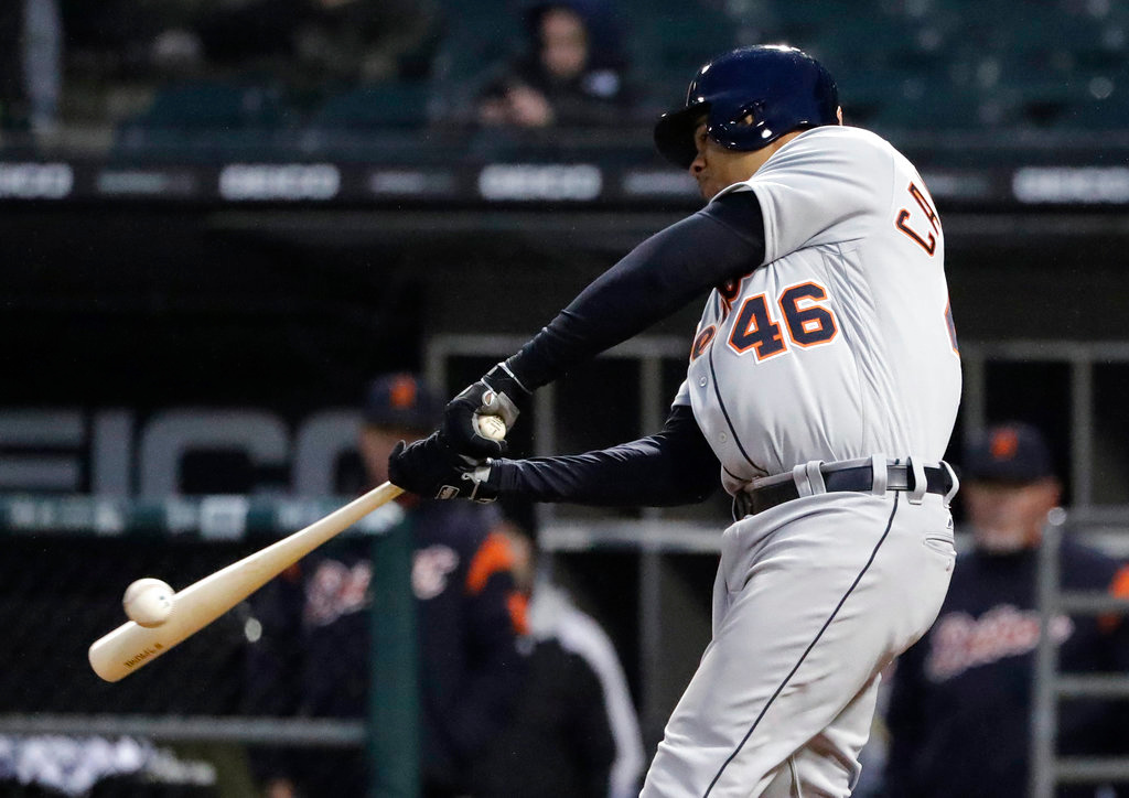 . Detroit Tigers\' Jeimer Candelario hits an RBI single against the Chicago White Sox during the 10th inning of a baseball game Thursday, April 5, 2018, in Chicago. The Tigers won 9-7. (AP Photo/Nam Y. Huh)