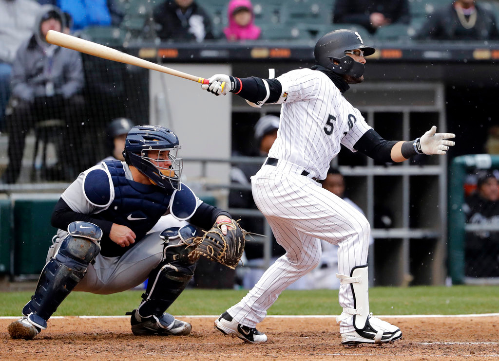 . Chicago White Sox\'s Yolmer Sanchez, right, hits an one-run triple during the fifth inning of team\'s baseball game against the Detroit Tigers, Thursday, April 5, 2018, in Chicago. (AP Photo/Nam Y. Huh)