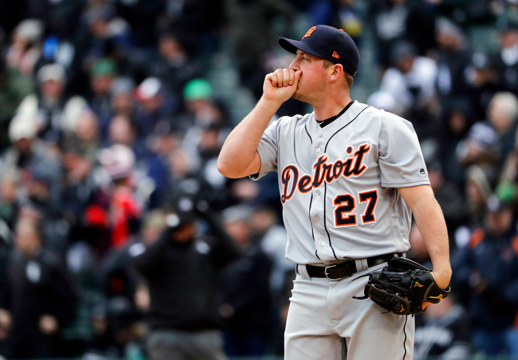 . Detroit Tigers starter Jordan Zimmermann reacts after Chicago White Sox\'s Yolmer Sanchez hit a two-run triple during the first inning of the White Sox home-opener baseball game Thursday, April 5, 2018, in Chicago. (AP Photo/Nam Y. Huh)