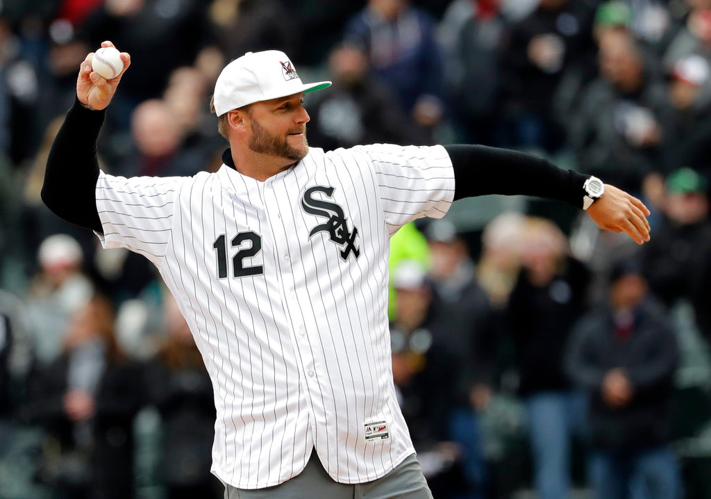 . A.J. Pierzynski throws out the ceremonial first pitch before the Chicago White Sox season home-opening baseball game against the Detroit Tigers, Thursday, April 5, 2018, in Chicago. (AP Photo/Nam Y. Huh)