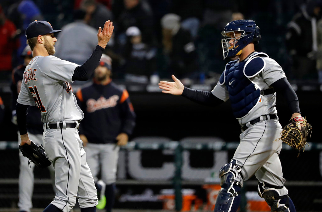 . Detroit Tigers closer Shane Greene, left, celebrates with catcher James McCann after the Tigers defeated the Chicago White Sox 9-7 in a baseball game Thursday, April 5, 2018, in Chicago. (AP Photo/Nam Y. Huh)