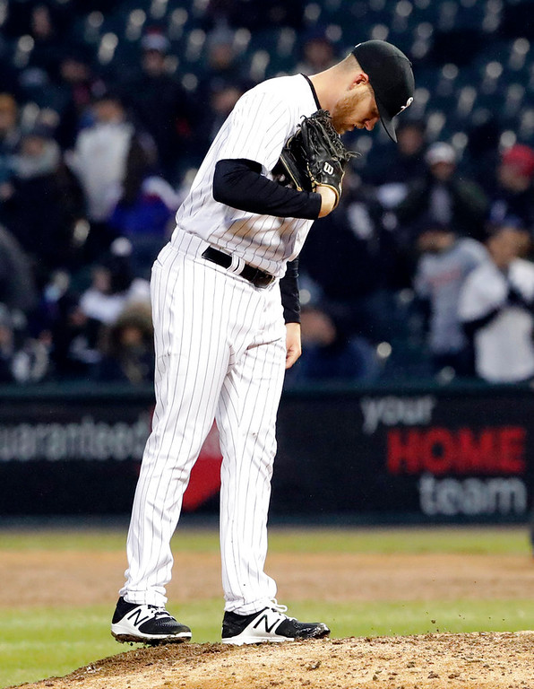 . Chicago White Sox relief pitcher Aaron Bummer looks down after Detroit Tigers\' Mikie Mahtook scored on a fielder\'s choice during the 10th inning of the White Sox home-operner baseball game Thursday, April 5, 2018, in Chicago. (AP Photo/Nam Y. Huh)