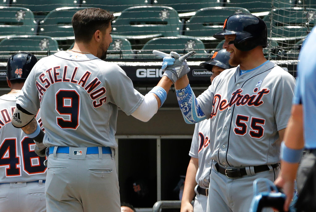 . Detroit Tigers\' Nick Castellanos, left, celebrates with John Hicks after hitting a two-run home run against the Chicago White Sox during the first inning of a baseball game in Chicago, Sunday, June 17, 2018. (AP Photo/Nam Y. Huh)