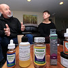 Tim and Kim Swart of Westminster talk about there new on online store that sells CBD products. Some of their products sit on the table in front of them while they talk. From left is CBD drops, CBD rose oasis massage oil, CBD Gummies, a vaping pen some more CBD drops and some CBD salve. SENTINEL & ENTERPRISE/JOHN LOVE