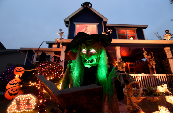 a witch talks and lights up at tim kohlers house in longmont - Halloween Decorated House