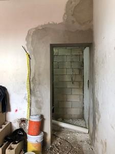 door to 1st bathroom