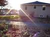 Unser Haus mit Sonnenstrahlen