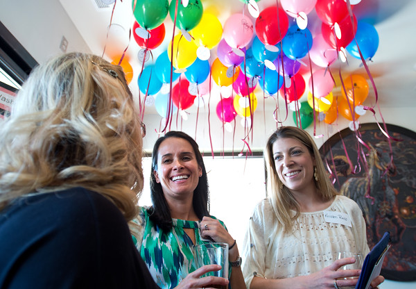 """BEST BEST BEST<br /> Erin Pierce and Kristen Reiss, parents of Mesa Elementary students, converse with a visitor at the balloon raffle during school's """"Denim and Bling"""" Spring Fling fundraiser at Under the Sun in Boulder. Low state funding has increased the school's reliance on fundraising.<br /> More photos:  <a href=""""http://www.dailycamera.com"""">http://www.dailycamera.com</a><br /> Autumn Parry/Staff Photographer<br /> April 24, 2016"""